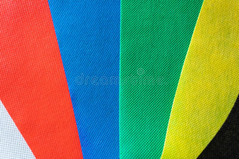 Color tissue samples background of white, red, blue, green, yellow and black colors. Different color swatches - Image stock photos