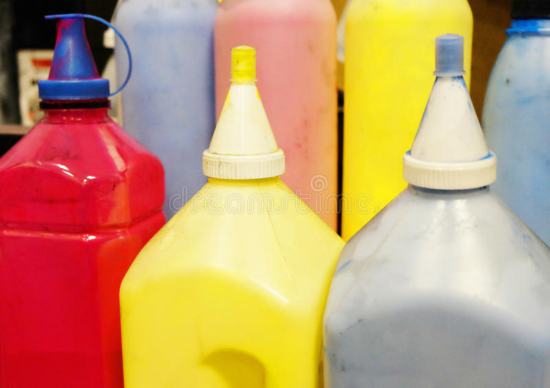Color toner for cartridges. In dirty tanks . real photos from the service workshop royalty free stock images