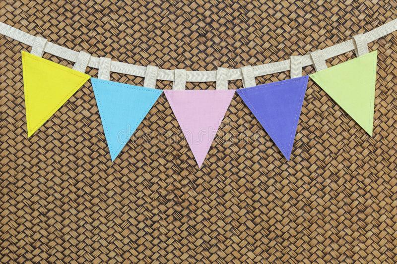 Color triangle fabric flag on wood pattern background royalty free stock images