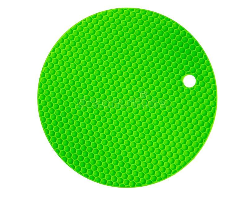 Color verde para los platos calientes, aislamiento del cojín del silicón en el fondo blanco imagen de archivo libre de regalías