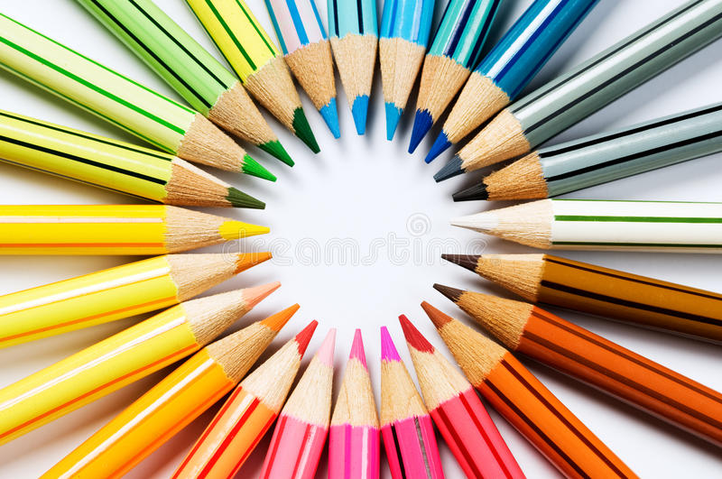 Color wheel. Colored pencils forming a color circle White background stock photography