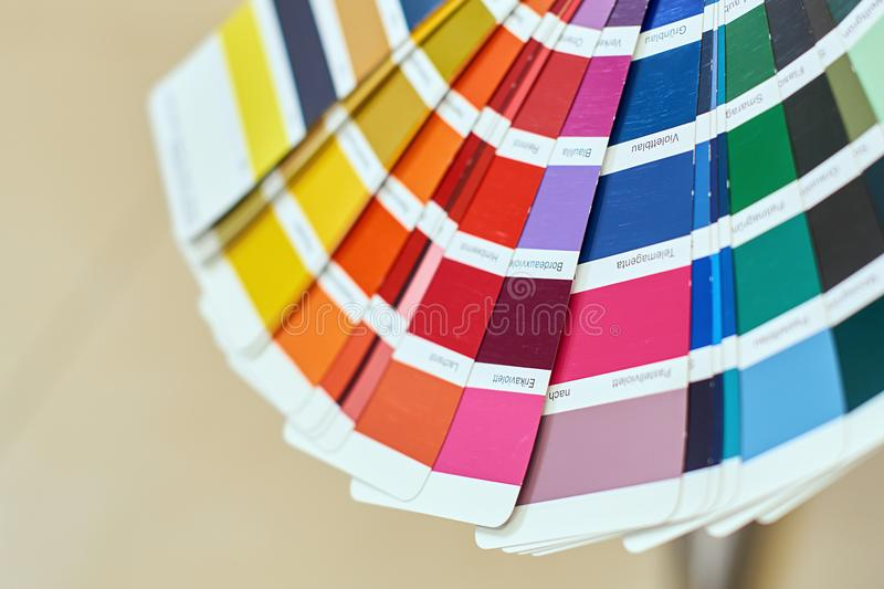 Color wheel for choosing paint tone, samples of various paints. Close-up of color wheel or palette for choosing paint tone, samples of different paints stock image