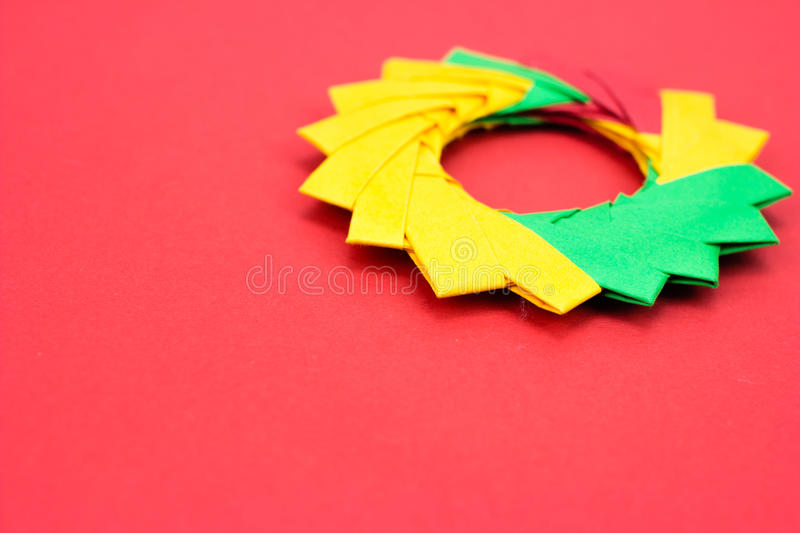 Color wheel origami. On red background royalty free stock images