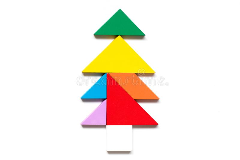 Color wood tangram puzzle in tree shape. On white background stock images