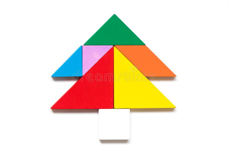 Color wood tangram puzzle in tree shape. On white background stock photos
