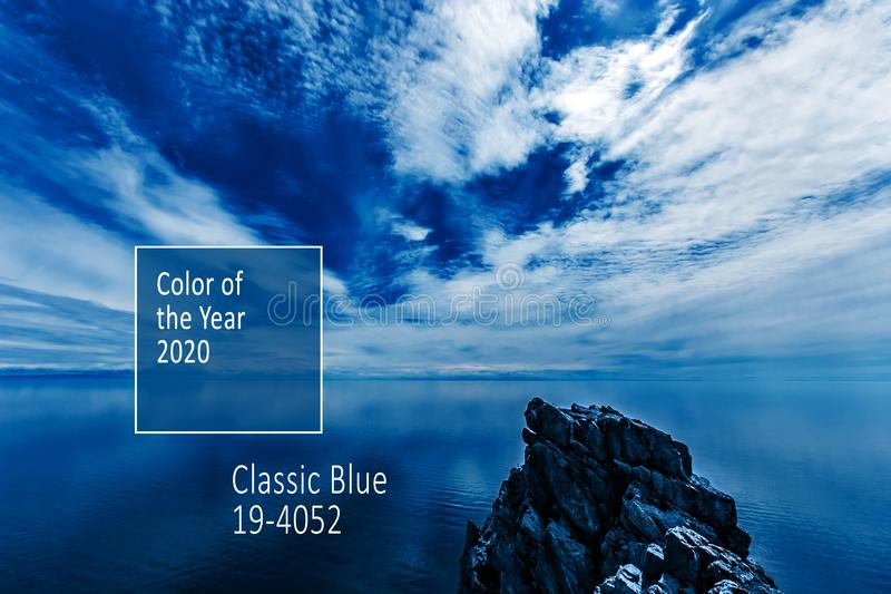 Color of the Year 2020 Classic Blue Pantone. Beautiful seascape with Lake Baikal and incredible amazing sky with clouds. royalty free stock photography