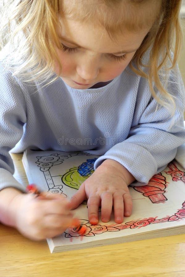 Coloração no livro fotografia de stock
