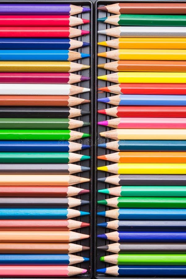 Colora lápis com a capa de plástico isolada em clo pretos do fundo imagens de stock royalty free