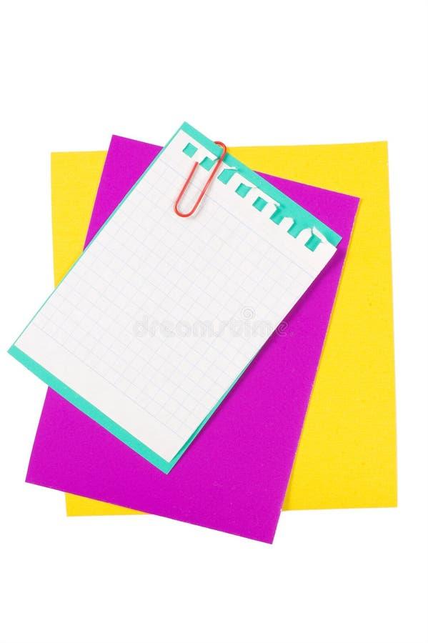 Colora o papel com um grampo de papel fotos de stock