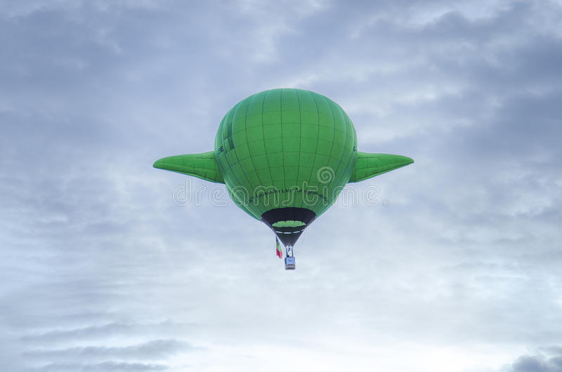 Colorado Annual Balloon Festival. Green colored hot air balloon against the soft blue sky at take off at the Colorado Springs Memorial Park Lake for the Annual stock photography