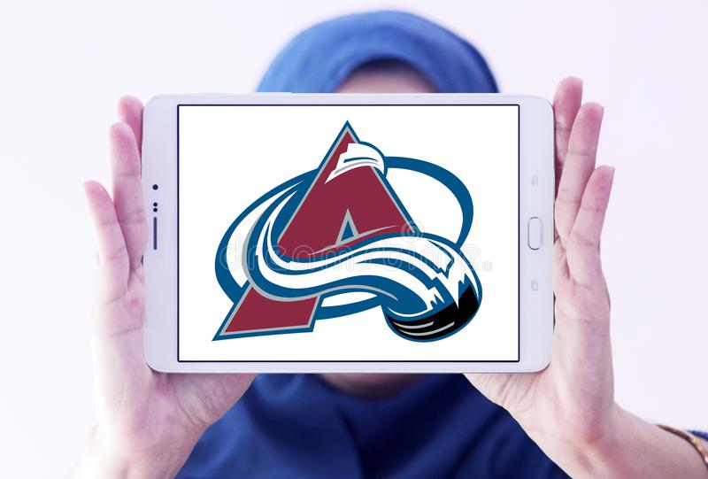 Colorado Avalanche ice hockey team logo. Logo of Colorado Avalanche ice hockey team on samsung tablet holded by arab muslim woman. The Colorado Avalanche are a royalty free stock photo