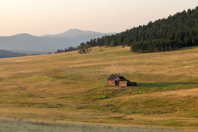 Colorado landscape with old abandoned wooden shack. Squaw Pass road near Evergreen, Colorado stock photography