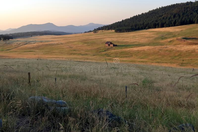 Colorado landscape with old abandoned wooden shack stock photography