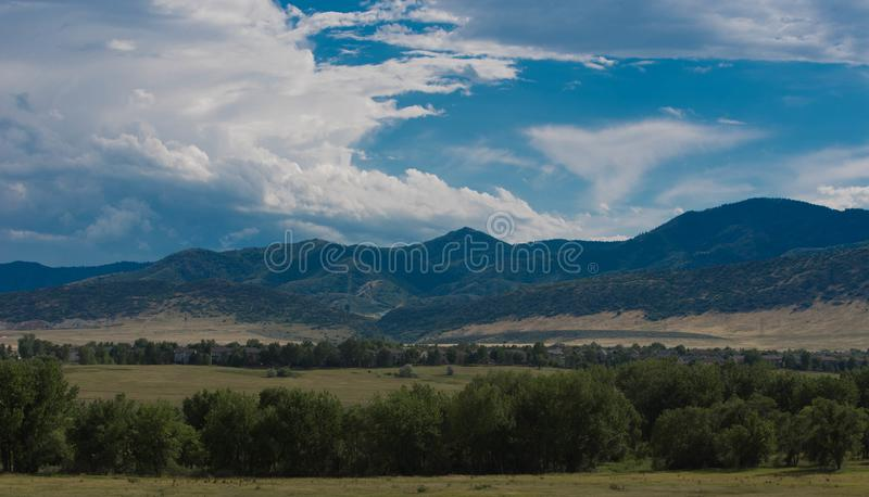 Colorado mountains as a storm travels north. Mountain side view of storms traveling north over the mountain faces stock photo