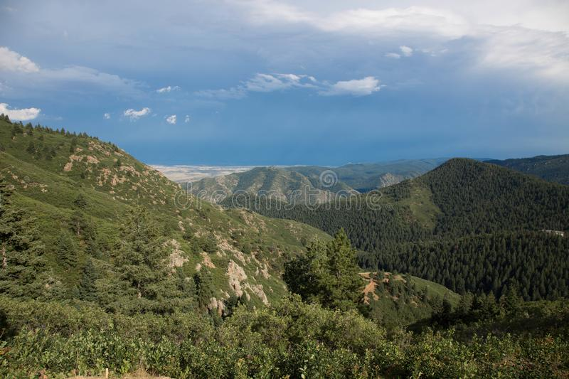 Colorado mountains as a storm travels north. Mountain side view of storms traveling north over the mountain faces stock photography