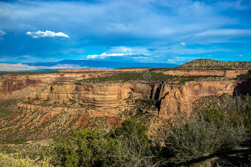 Wide view of massive rock walls in Colorado National Monument. Immense rock walls and vast canyons characterize Colorado National Monument near Grand Junction stock image