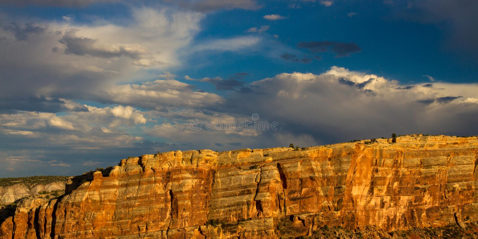 Steep stone walls and dramatic sky in Colorado National Monument near the towns of Grand Junction and Fruita royalty free stock photography
