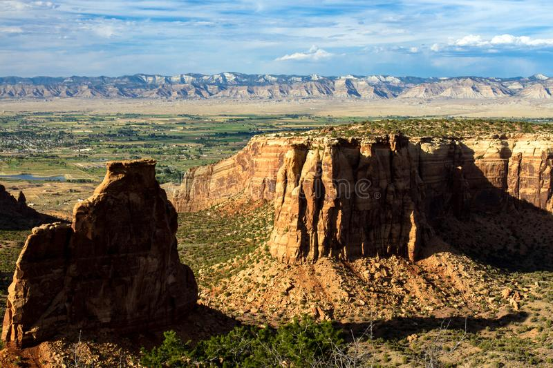 Striking `Grand View` rock formations at sunset in Colorado National Monument. At sunset, the `Grand View ` at Colorado National Monument glows with warm light stock image