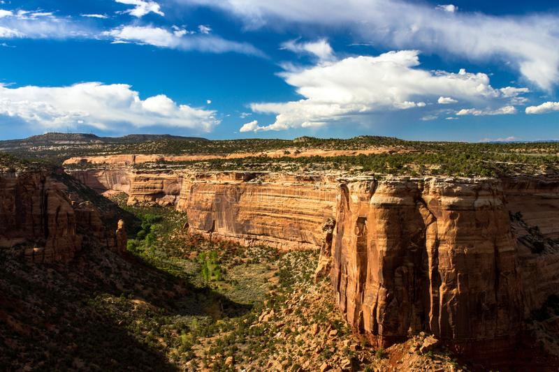 Massive rock walls and vast canyons characterize Colorado National Monument. Ute Canyon, only half of which is shown here, is an immense geological feature in royalty free stock photos