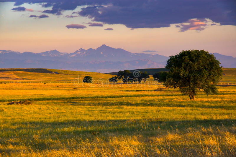 A Colorado Plains Sunrise. Sunrise takes hold over the Colorado plains as Longs Peak is seen on the horizon royalty free stock photos