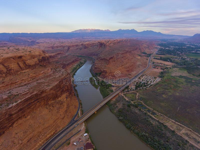 Colorado River aerial view, Moab, Utah, USA. Aerial view of Colorado River and La Sal Mountains near Arches National Park at sunset in Moab, Utah, USA stock image