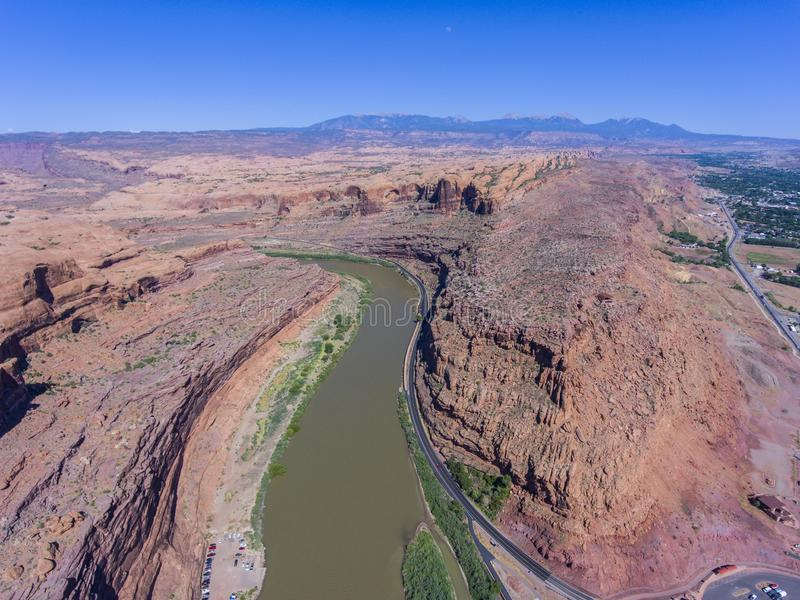 Colorado River aerial view, Moab, Utah, USA. Aerial view of Colorado River and La Sal Mountains near Arches National Park in Moab, Utah, USA stock photos