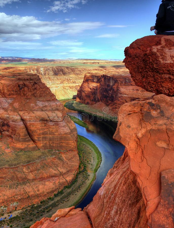 Colorado River, Horseshoe Bend Trail, Page, Arizona. High desert plateau trail overlooking Colorado River, Horseshoe Bend near Page town in Arizona. Tourist stock photo
