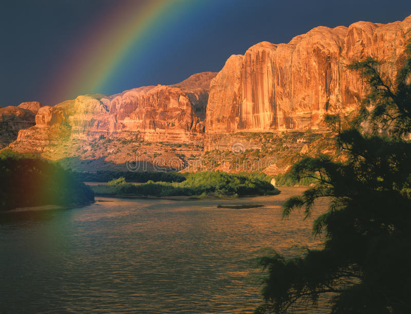 Colorado River Rainbow. Red Rock Canyon along the Colorado River with Rainbow stock photography