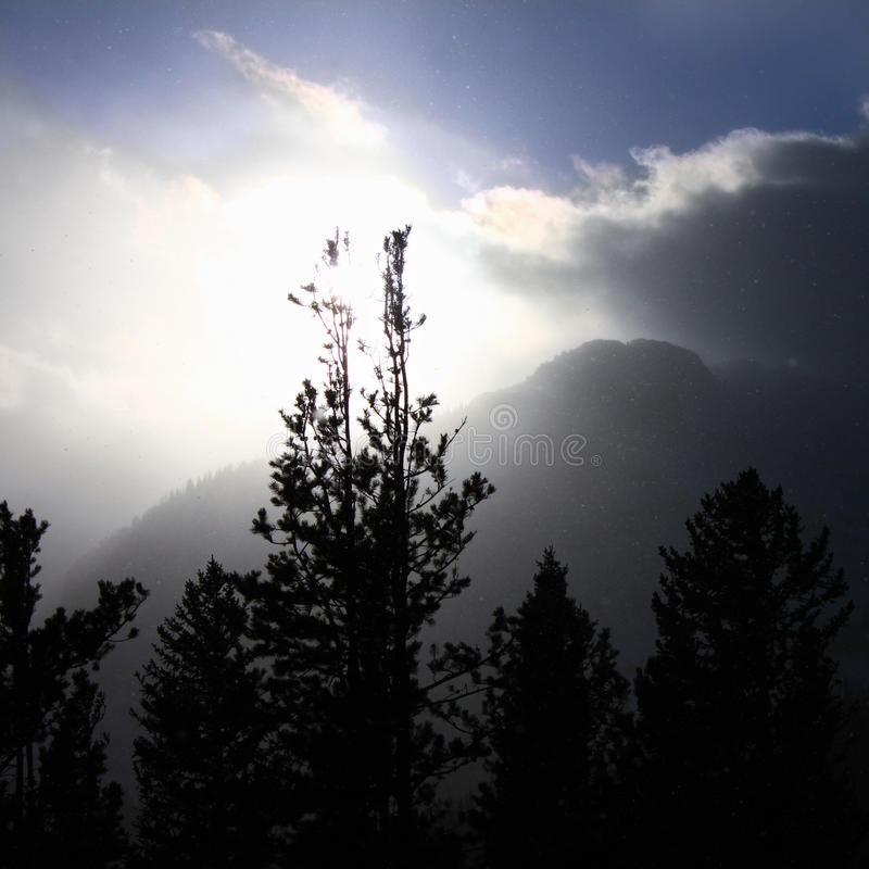 Colorado Rockies Snowstorm. Snowstorm pushes forward against fading sunlight in the Colorado Rockies stock photos