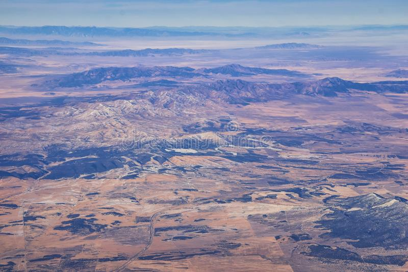 Colorado Rocky Mountains Aerial view from airplane of abstract Landscapes, peaks, canyons and rural cities in southwest Colorado a royalty free stock photos