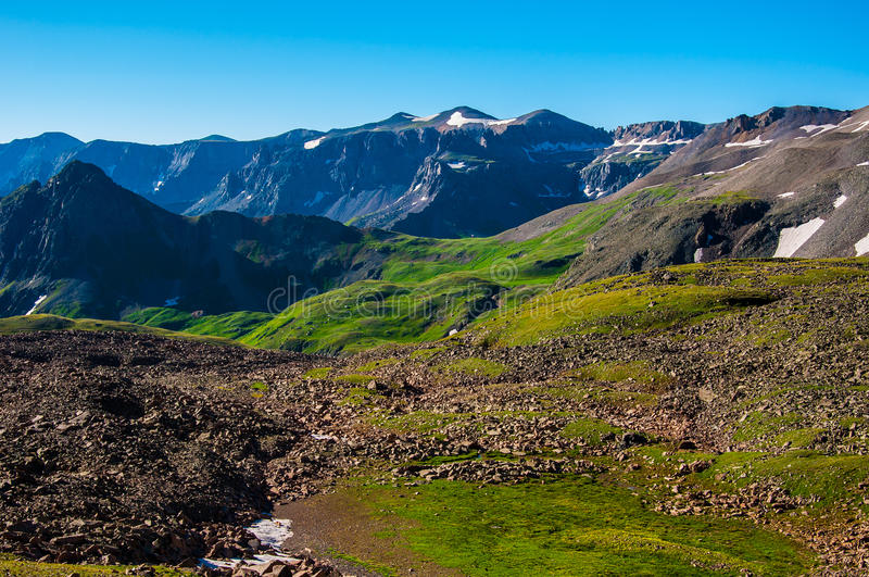 Colorado Rocky Mountains Sneffels Range. While climbing up Mount Sneffels I looked back and took this picture of the amazing landscape with green tundra and royalty free stock photos