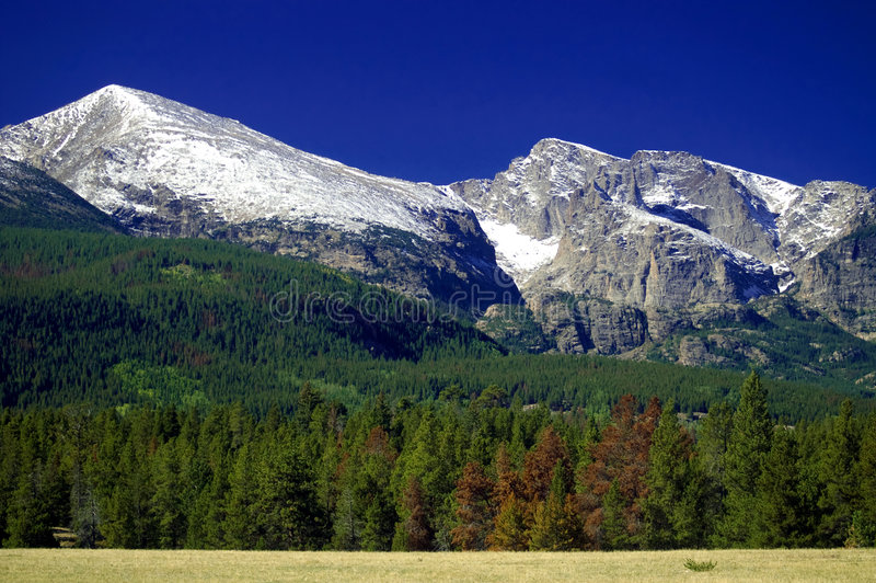 Colorado Rocky Mountains with snow. And blue sky, in Rocky Mountain National Park stock photography