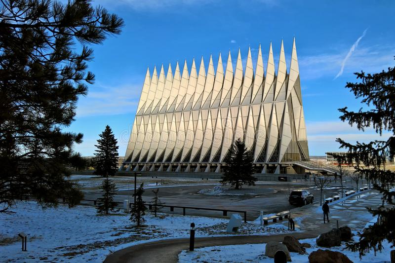 US Air Force Academy Chapel in winter. COLORADO SPRINGS, CO - DECEMBER 13, 2015: United States Air Force Academy Cadet Chapel lights up over an area of shade stock photo