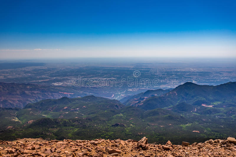Colorado Springs from Pikes Peak. Pikes Peak is the highest summit of the southern Front Range of the Rocky Mountains. The ultra-prominent fourteener is located royalty free stock image
