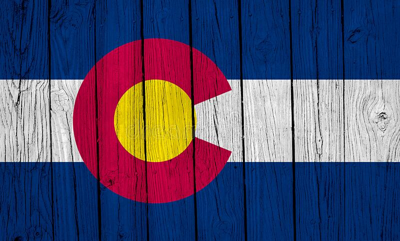 Colorado State Flag Over Wood Planks. A grunge Colorado state flag over wood planks royalty free stock photography