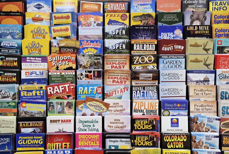 Colorado Tourist Brochures. JULY 6, 2017 - WESTMINSTER, CO : Colorful Colorado Tourist Brochures arranged in a rack in a hotel lobby in Westminster, Co on July 6 stock image