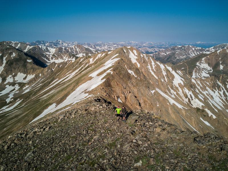 Hikers atop the beautiful mountains of the Sawatch Range. Colorado Rocky Mountains royalty free stock photography