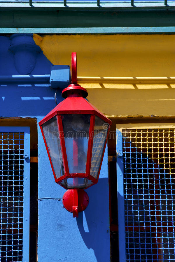 A colorated wall in la boca buenos aires argentina. Red street lamp and a colorated wall in la boca buenos aires argentina stock image