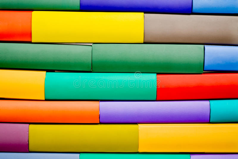 Colorated wall made of different book stock photos