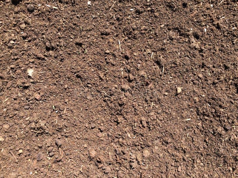 Colore al suolo di Brown del fondo di struttura del suolo fotografie stock