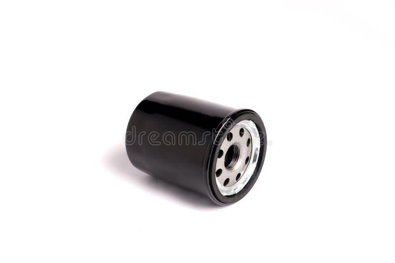 Colore del nero del filtro dell'olio che pulisce il motore a combustione interna su un fondo bianco immagini stock