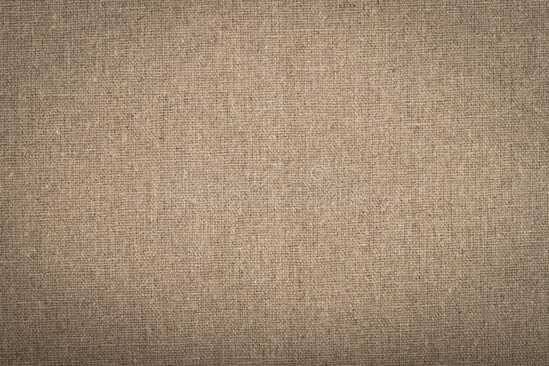 Colore di Brown del fondo della tela di sacco del tessuto naturale fotografia stock libera da diritti