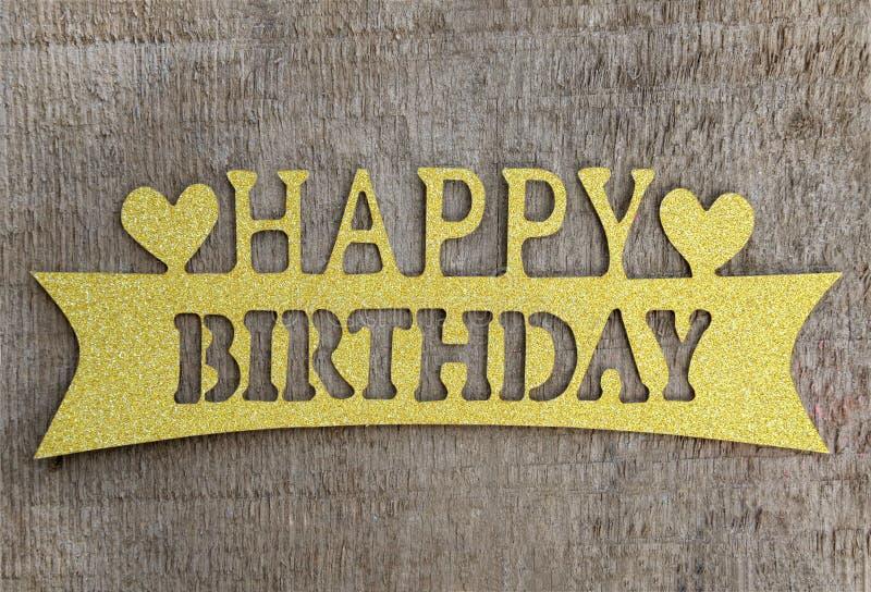 Colore felice di legno dell'oro del biglietto di auguri per il compleanno fotografia stock libera da diritti