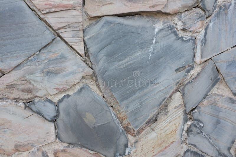 Colore naturale del fondo di struttura della parete di pietra fotografia stock libera da diritti