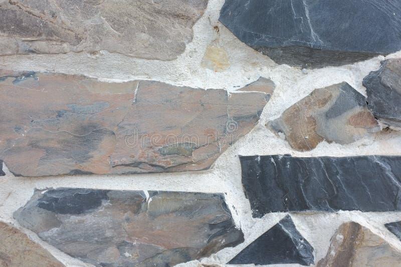 Colore naturale del fondo di struttura della parete di pietra fotografie stock