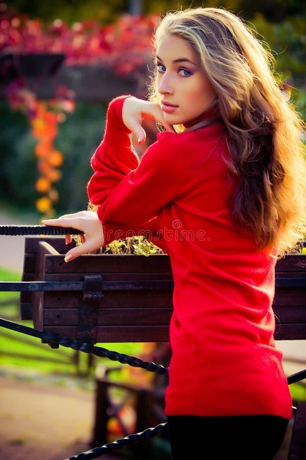 colore rosso della signora fotografia stock