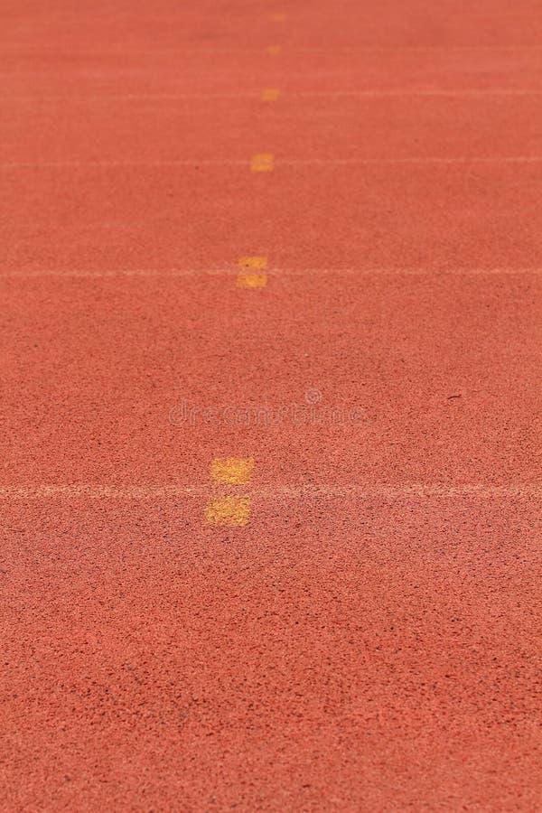 Colore rosso standard di gomma della pista corrente immagini stock
