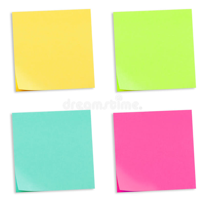 Colored Adhesive Note Papers. 4 colored adhesive note papers, yellow, green, turquoise and pink stock photo