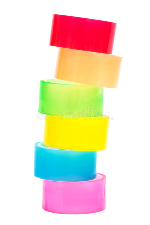 Colored adhesive tape. Colored and transparent adhesive tape on a white background stock photo