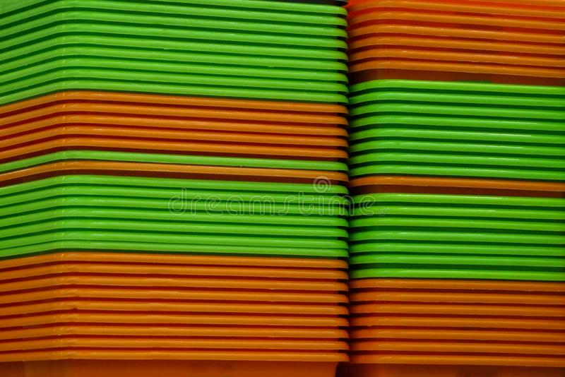 Green orange plastic texture from a row of crates stock photography